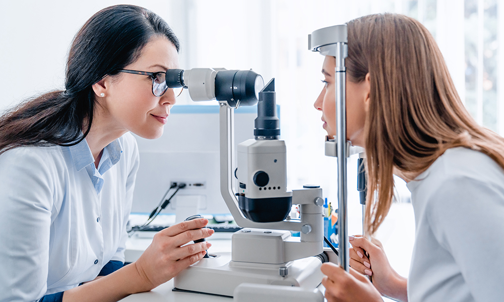 when-should-you-refer-to-a-neuro-optometrist-optometrist-checking-a-patients-eyes